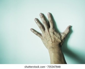 left hand with blood vessel from man worker put on white background with shadow (idea for halloween concept)