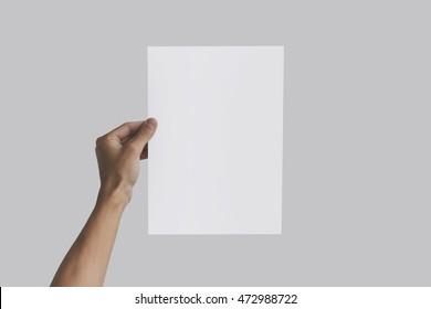 Left hand holding A4 paper in the left hand. Leaflet presentation. Pamphlet hand man. Man show offset paper. Sheet template. Book in hands. Booklet folding design. Fold paper sheet display read.