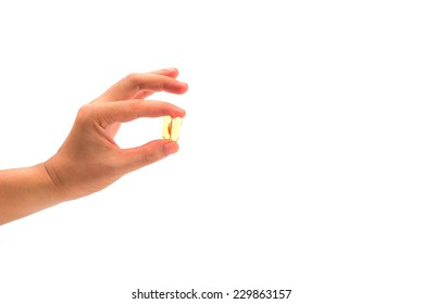 left hand holding with Cod liver oil isolated on white