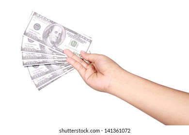 left hand holding several dollar bills, isolated on white background