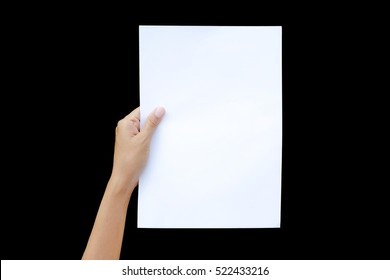Left hand holding sheet of paper isolated on black background.