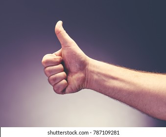 left hand show thrumb finger. hand sign for like, good and awesomeness., excellent.