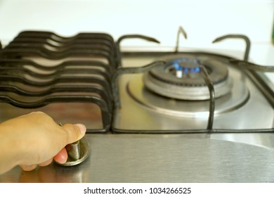 Left hand woman opening gas burning from a kitchen gas stove. Prepare to cooking some food.