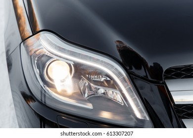 Left LED adaptive headlight of a modern car.