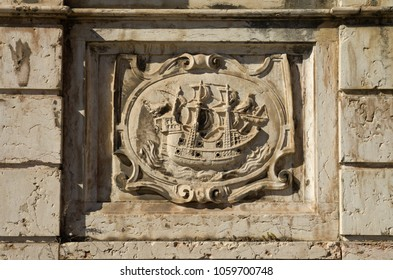 Left low relief panel of Kings fountain monument (Chafariz Del Rei) portraying a ship. The Kings fountain was built in the XIII century and rebuilt in 1864. Alfama district, Lisbon, Portugal.