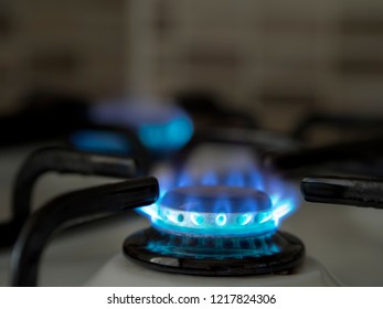 left open oven gas in the home kitchen. close-up blue colored burning gas