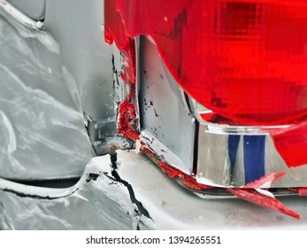 Left rear light system of a car destroyed by a car rear-end collision and splintered. Close-up