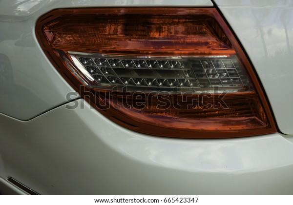 Left rear lights of sedan car