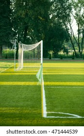 left side view of standard goal and net in football pitch or soccer field, sport equipment in the stadium