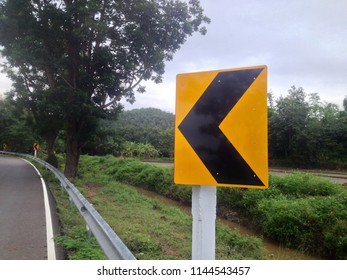 Left Sign Caution On Road