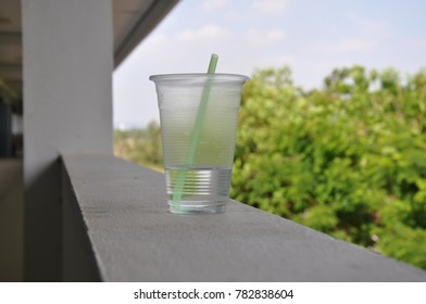 The left water in plastic glass