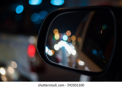 Left Wing Mirror Car  and Clourfull Bokeh Background in City night on the street