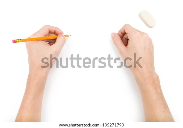 Left-hander with pencil writing something. Isolated on white