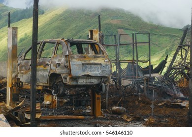 leftover of burnt out property automobile workshop after fire.