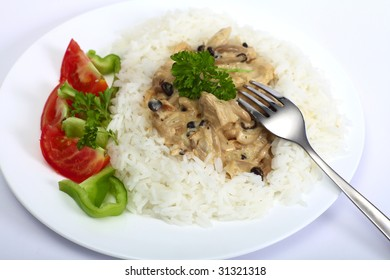 Left-over chunks of roast turkey cooked up in a mushroom and cream sauce and served with white rice and a salad