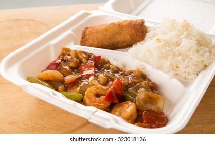 Leftover Kung Pao Shrimp in styrofoam takeout box.