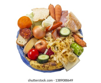 leftover uneaten food in garbage with vegetables, fruits, noodles from above, wasting, wastage, waste