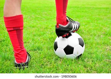 leg of football player with ball