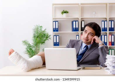 Leg injured employee working in the office