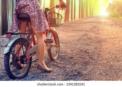Leg of kid girl prepare to riding bicycle along forest road to light destination.Healthy Lifestyle and Well Growth Concept.