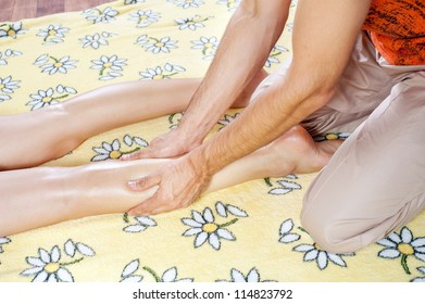 Leg massage with massage oil in the cabin