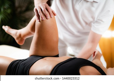 Leg Osteopathy treatment. Chiropractor with patient