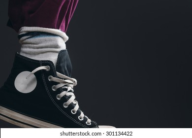 a Leg with Pants, Socks and Sneakers