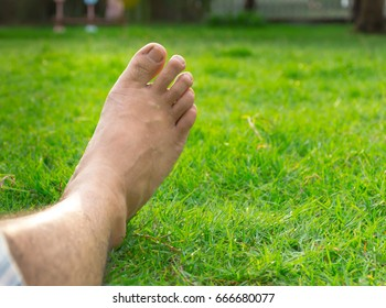 Leg right  man lying in the lawn