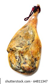 a leg of spanish serrano ham on a white background