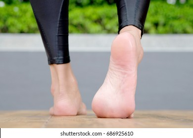 Leg of woman walk step foot on wooden floor. Health and Fitness Concepts