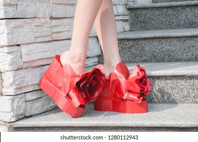 Leg woman wearing female high heel red shoes with red rose, DIY recycle shoes by paper.
