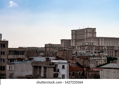 Legacy of communism and landmarks of Romania concept theme with the People's house (casa poporului) surrounded by communist apartment buildings. The building serves as Romanian palace of parliament