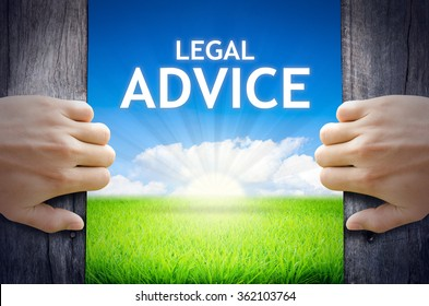 Legal Advice. Hand opening an old wooden door and found Legal Advice word floating over green field and bright blue Sky Sunrise.
