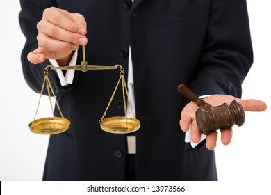 legal concept with businessman holding gavel and scales of justice