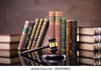 Legal concept. Judges gavel on law books background.