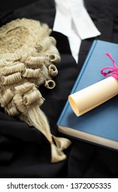 Legal Concept Still Life Of Barristers Wig With Gown And Brief