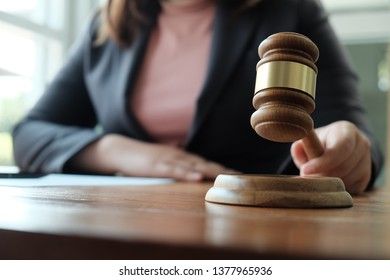 Legal counsel presents to the client a signed contract with gavel and legal law. justice and lawyer  law of advisor Concepts