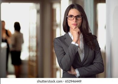 Legal defense attorney, woman business leader, ceo executive in thought at the company office location