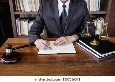 Legal law, advice and justice concept, Judge gavel with Justice lawyers, Counselor in suit or lawyer working on a documents in courtroom.