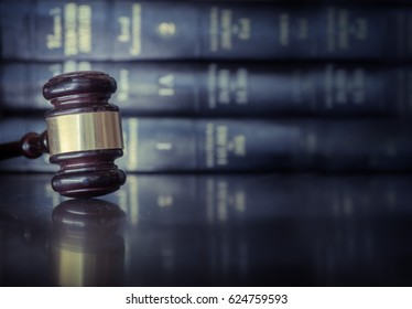 Legal law concept image, gavel on desk with books behind
