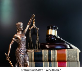 Legal law concept image.  Scales of justice with books and gavel