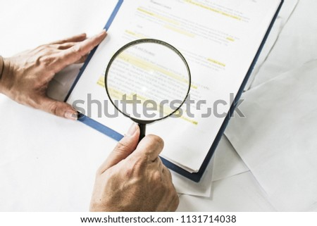 Legal Team Checking Fine Print On Stock Photo (Edit Now