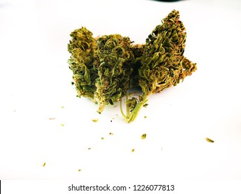Legal Weed Flower Cannabis Ganja Plant on White Board with Green Leaves