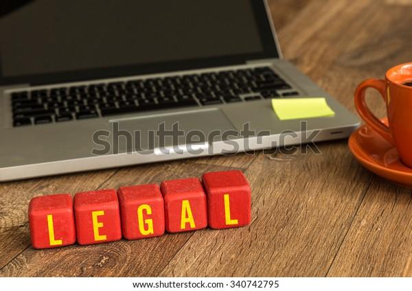 Legal written on a wooden cube in a office desk