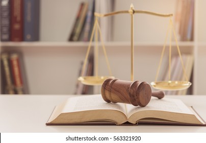 Legal,Law,Legislation Concept. Judge gavel on law books with scales of justice.