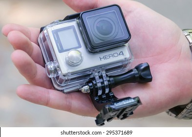 LEGANES, MADRID, SPAIN - JULY 4, 2015: A man holding Gopro Hero 4. Go pro Hero 4 is a compact, lightweight personal camera for taking action video and photography