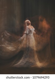 The legend of the Banshee fairy. Pale girl blonde, like a ghost, in a white vintage dress, flies, hovers in space. Branch of the soul. Light princess. Gothic photo of the sorceress and the magician