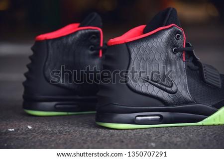 19803cb2fa738 Legendary Nike Air Yeezy 2 sport shoes shot outdoor on asphalt road line  background. Sport