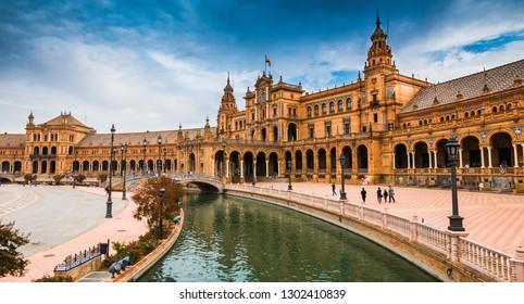 Legendary view of famous Plaza de Espana. Spanish square in the centre of old but magnificent Seville, Spain. Unique  moorish architecture.