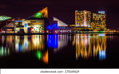 The Legg Mason Building and National Aquarium at night, in the Inner Harbor of Baltimore, Maryland.